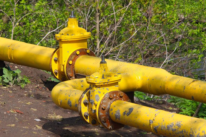 Yellow pipes of the gas pipeline royalty free stock image