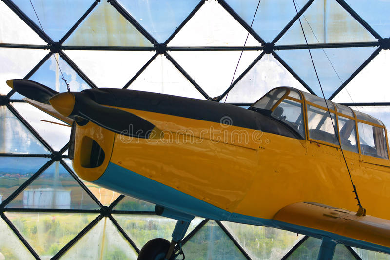 Yellow plane with blue belly stock photo