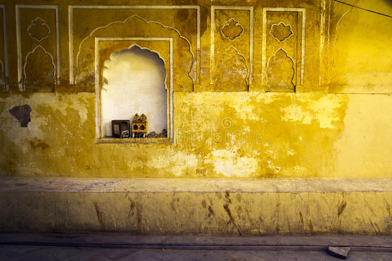 Yellow plaster and offering shrine, India, Jaipur stock images