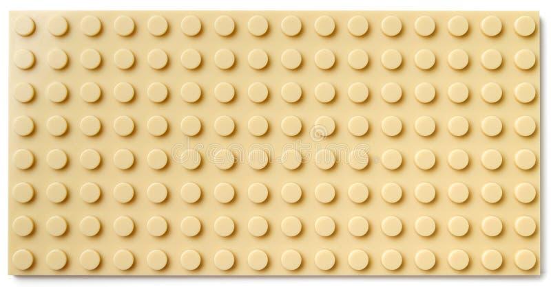 Yellow plastic baseplate stock photo