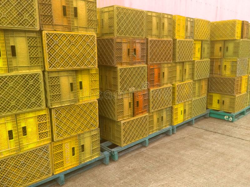 Yellow plastic basket used in agriculture. Storage box stock photo