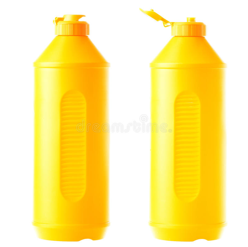 Yellow plastic bottle of detergent for ware. Yellow plastic bottle of detergent for ware isolated on a white background with the opened and closed stopper royalty free stock photo