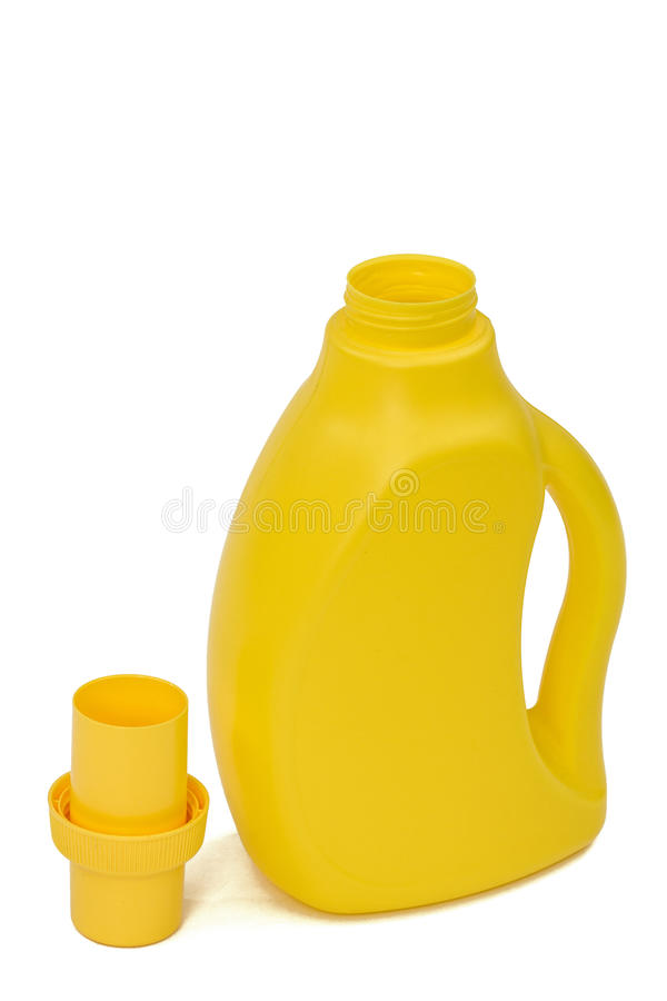 Yellow plastic bottle with a dispenser in cap, isolated on white. Background. Detergent for ware and cleaning in kitchen stock images