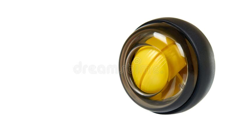 Yellow plastic gyroball. Exercise equipment for wrist. Sport tool. Isolated on white background. Copy space stock images