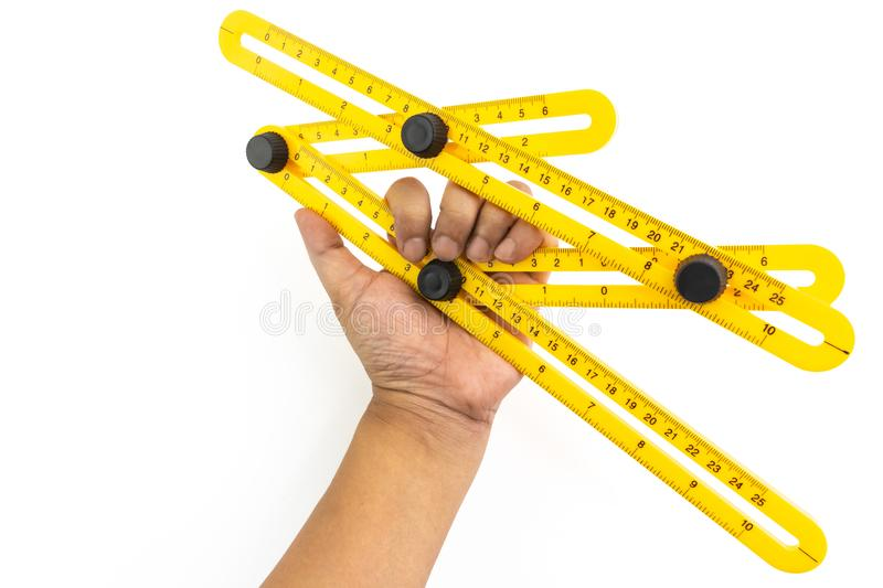 Yellow plastic measurement degree ruler in hand of man isolated. On white background stock photo