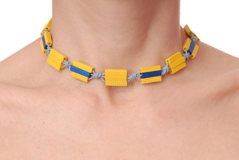 Yellow plastic necklace on female neck royalty free stock photos