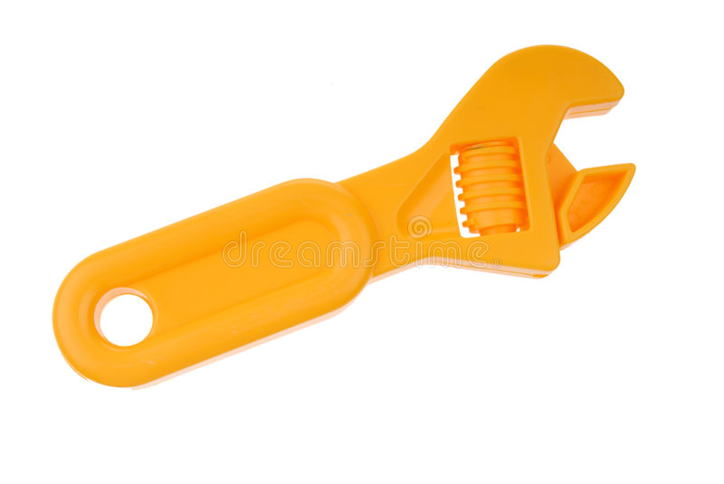 Yellow plastic toy wrench royalty free stock photography