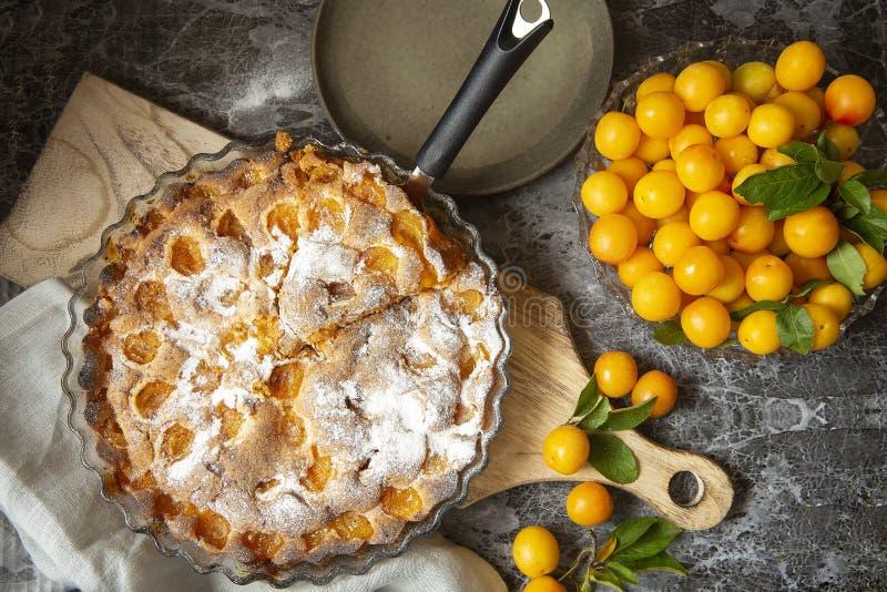Yellow plum mirabelle. Plum pie on a dark background. Summer fruit season. Harvest royalty free stock images