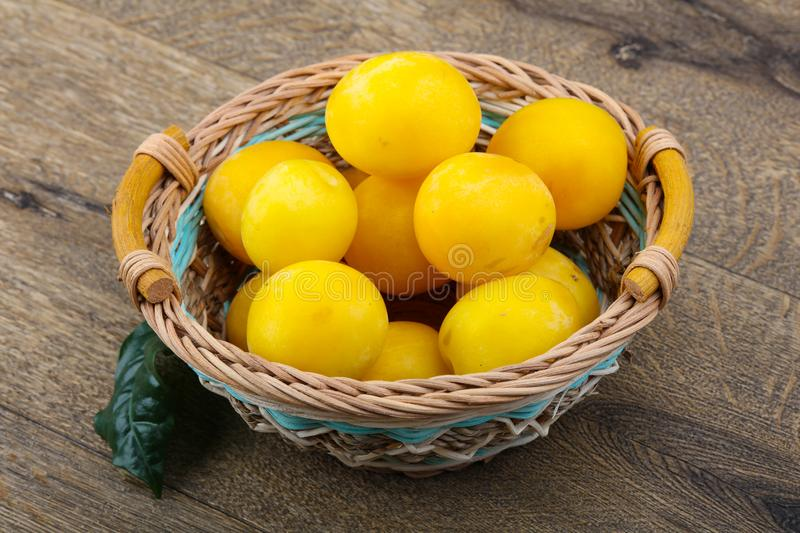 Yellow plums in the bowl royalty free stock photos