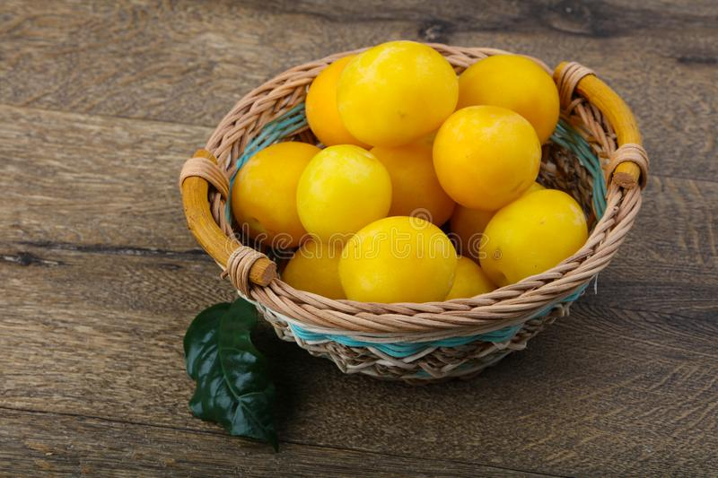 Yellow plums in the bowl royalty free stock image