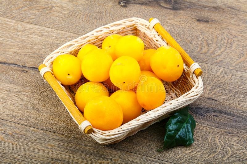 Yellow plums in the bowl stock images