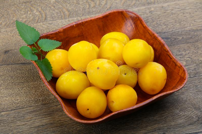 Yellow plums in the bowl royalty free stock images