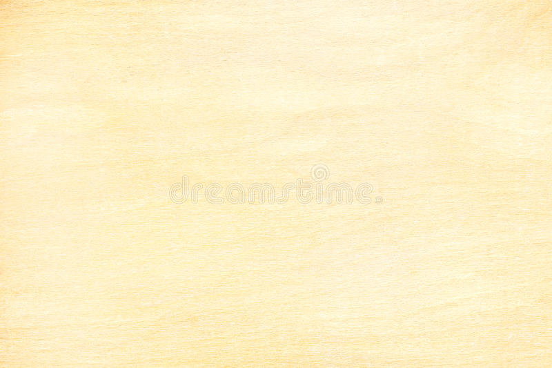 Yellow plywood board surface for background with natural pattern stock photo