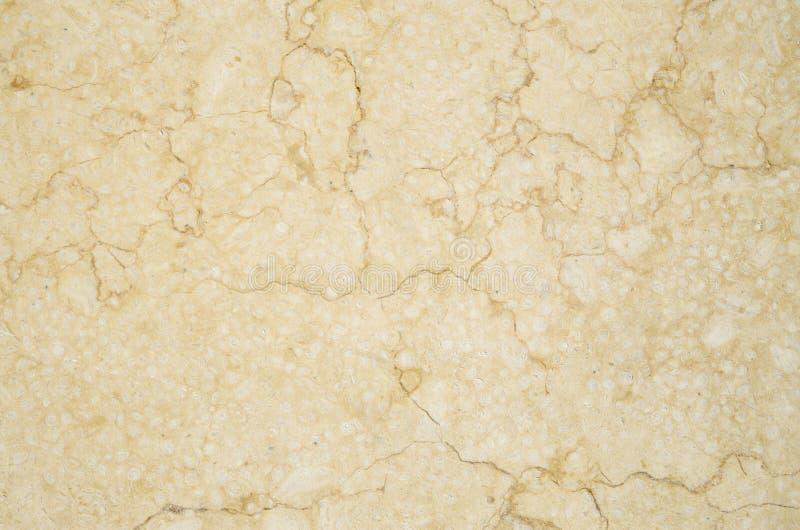 Yellow polished stone closeup. On wall stock image