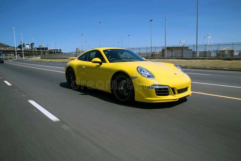 A yellow porshe 911 in motion royalty free stock photography