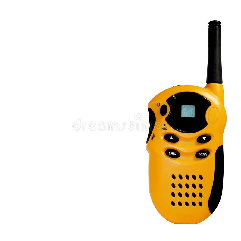 Yellow portable radio station with black buttons and an antenna on a white isolated background royalty free stock photo