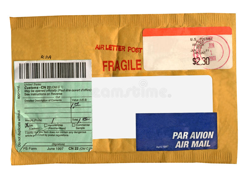 Yellow postage package (envelope), isolated. Single post (yellow colour) vintage mail package, isolated on white background. Paper recycling - safety for royalty free stock image