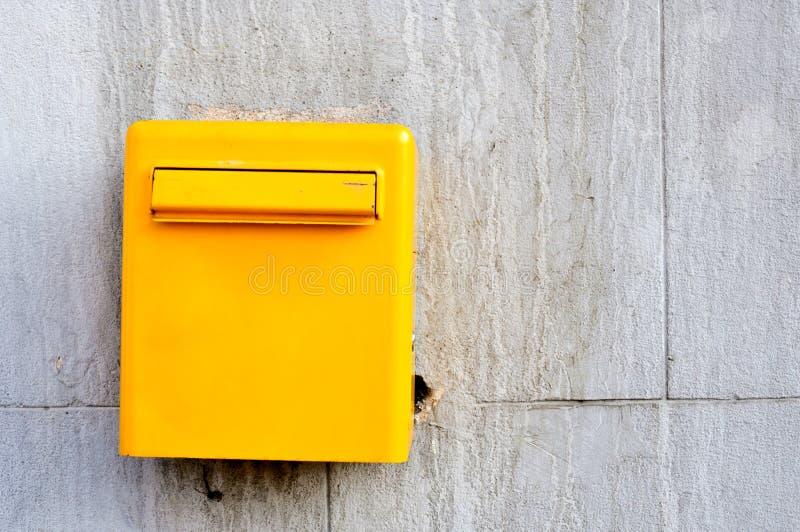 Yellow postbox stock photo