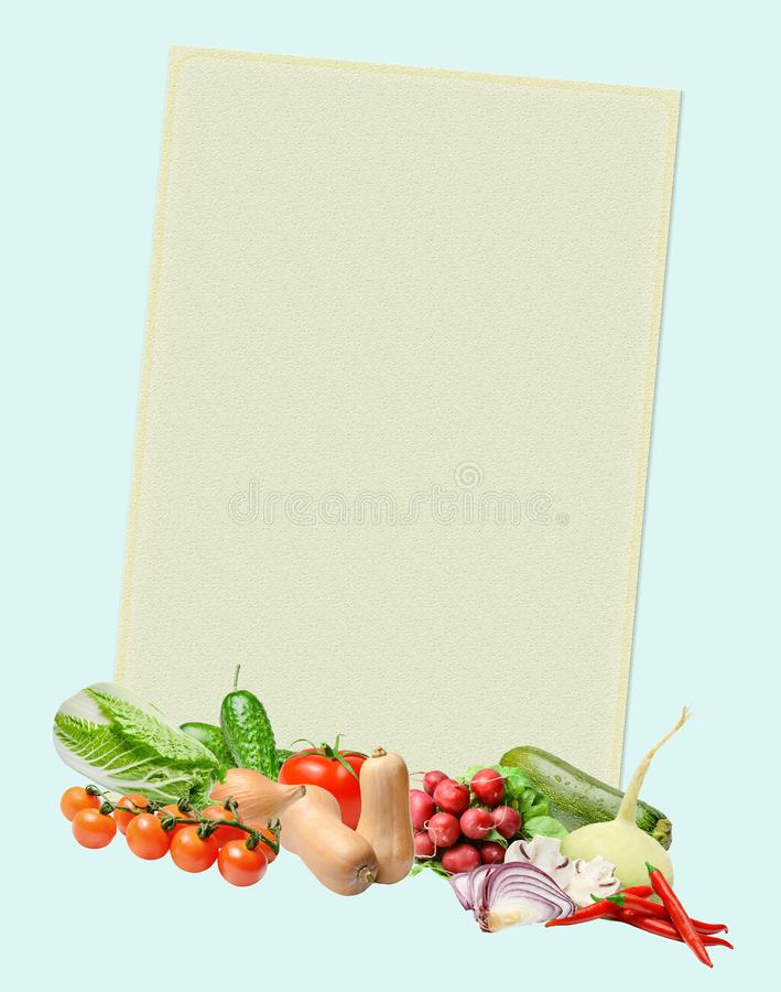 A yellow poster with a frame decorated with a composition of various vegetables against the background of a salad colored color. stock photography