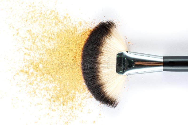 Yellow Powder Eyeshadow on a Brush, fashion beauty stock image