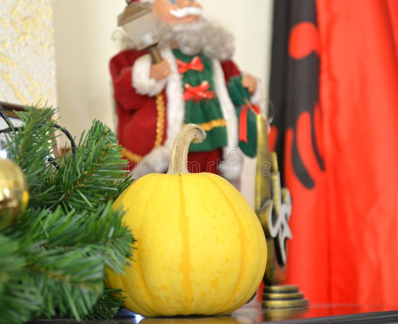 yellow pumpkin with santa claus decoration on the back royalty free stock photo