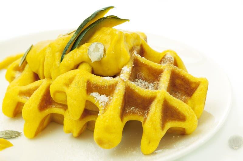 Yellow pumpkin waffles royalty free stock image