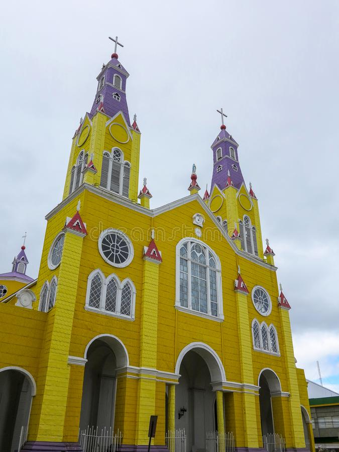 Yellow and purple church of Castro, Chiloe, Chile. Bright yellow and purple painted facade of the historic Iglesia San Francisco in Castro, capital of the island stock images