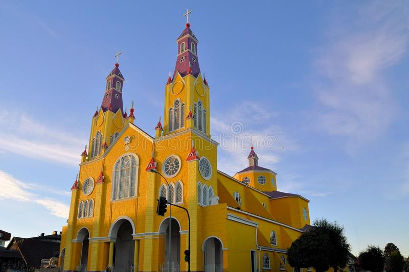 Yellow and purple church of Castro, Chiloe, Chile stock images