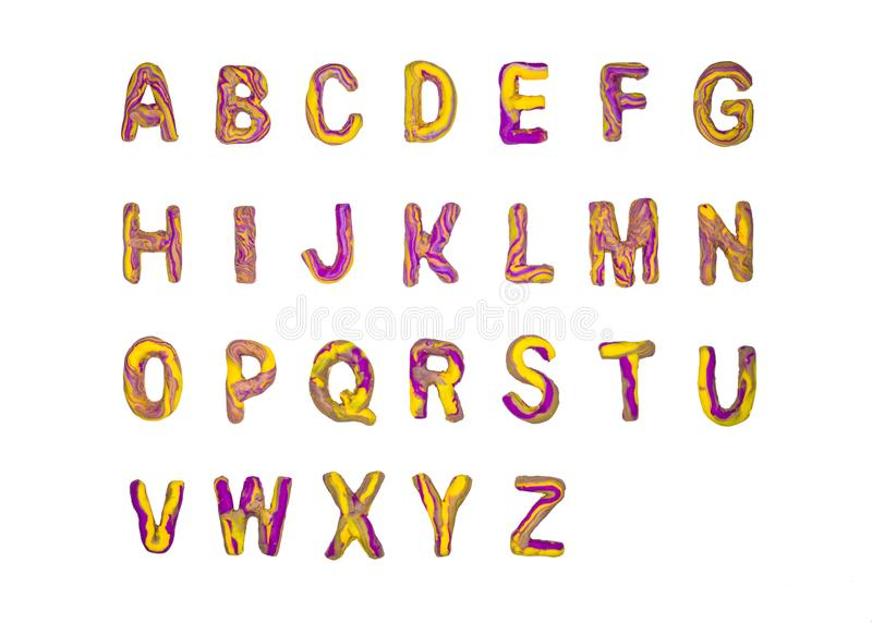 Yellow purple plasticine alphabet A-Z. Isolated on white background royalty free stock photos
