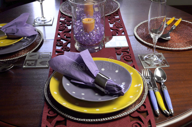 Yellow And Purple Table Place Setting Stock Photo