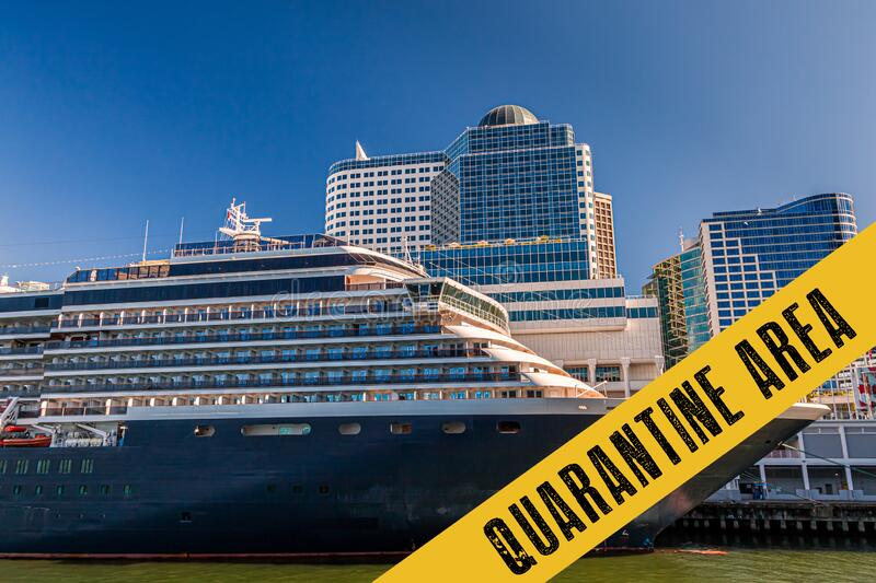 Yellow quarantine sign over a cruise ship at port stock image