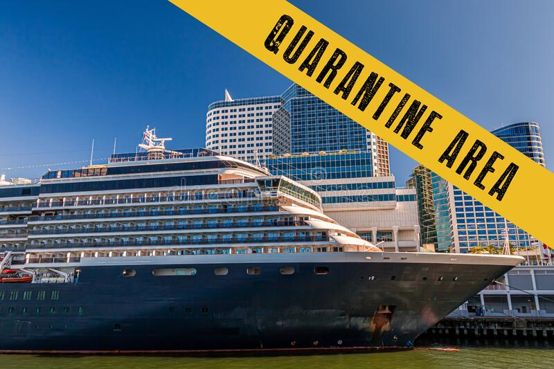 Yellow quarantine sign over a cruise ship at port royalty free stock photo