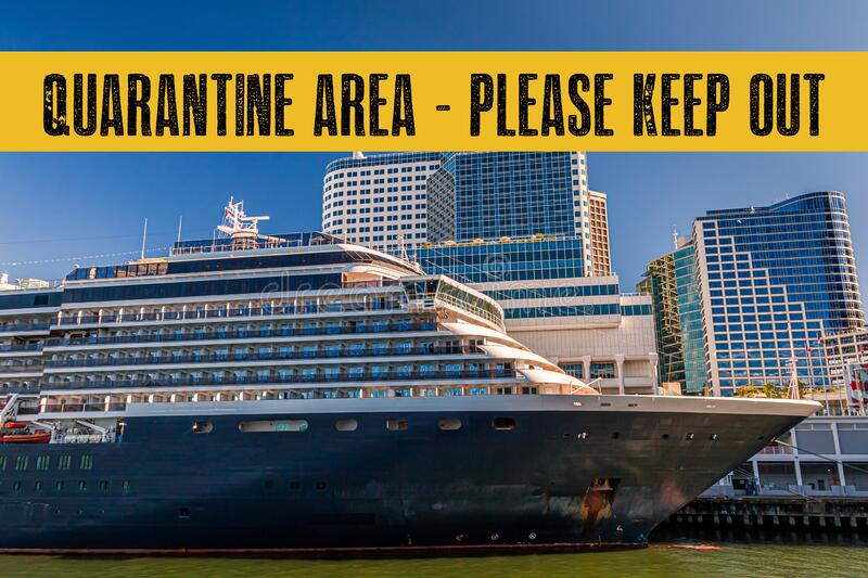 Yellow quarantine sign over a cruise ship at port stock photo