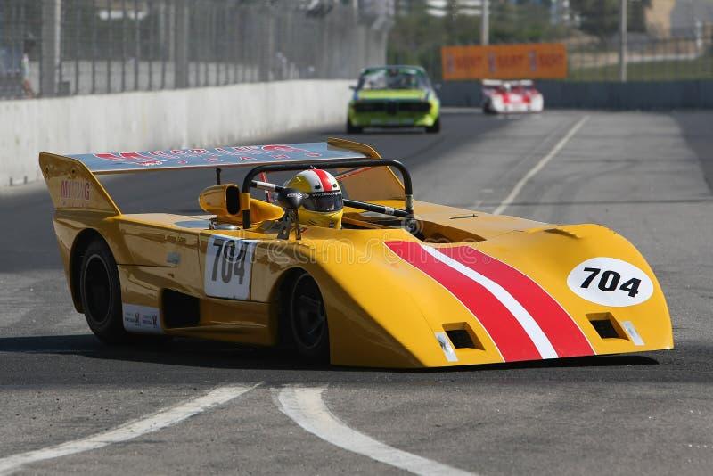 Yellow race car stock photography