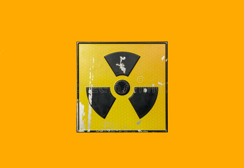 Yellow radioactive sign. On orange background stock photo