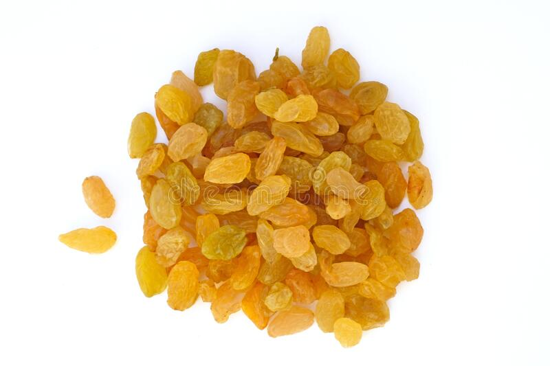 Yellow raisins of medium size from one grape of white grapes. Raisins on a white background top view. Dried grapes stock photography