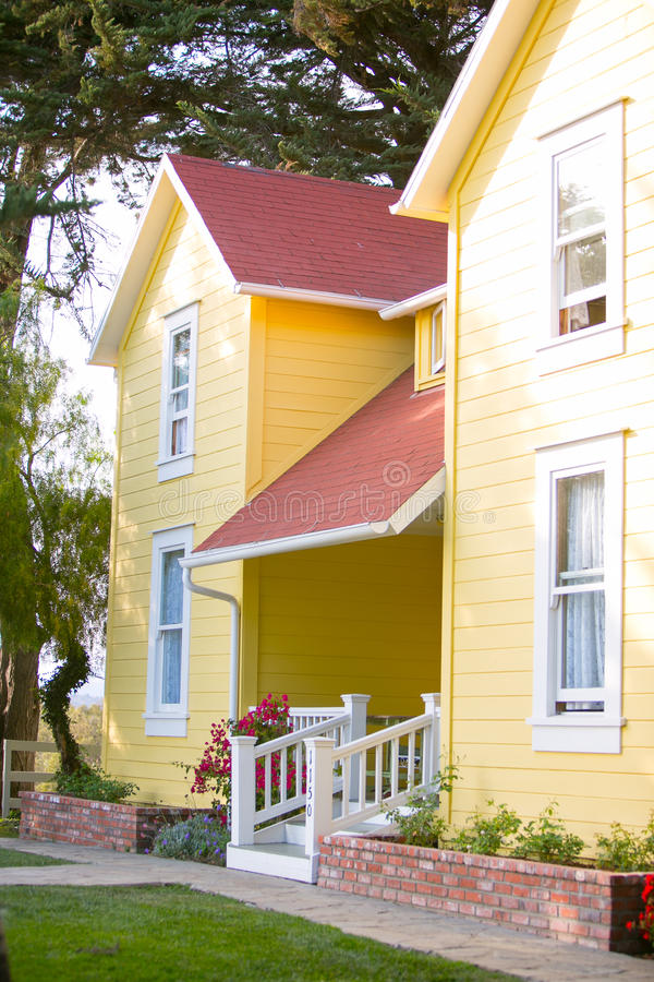 Yellow ranch house and white hand rail stock images