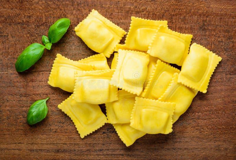 Yellow Ravioli and basil royalty free stock image