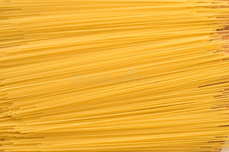 Yellow raw dry spagetti, background, texture. Yellow raw spagetti, background, texture stock photo