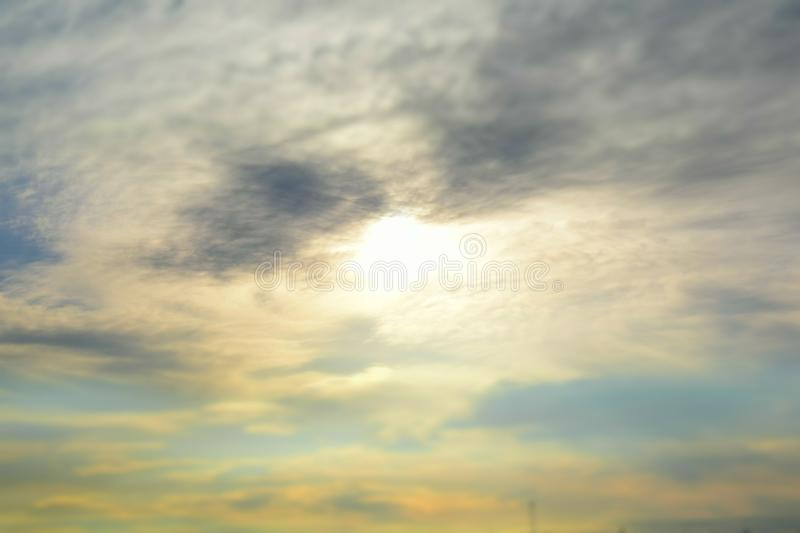 Yellow rays of sunset sun, absorbed clouds, and painted into interesting crimson colors of a decline royalty free stock image