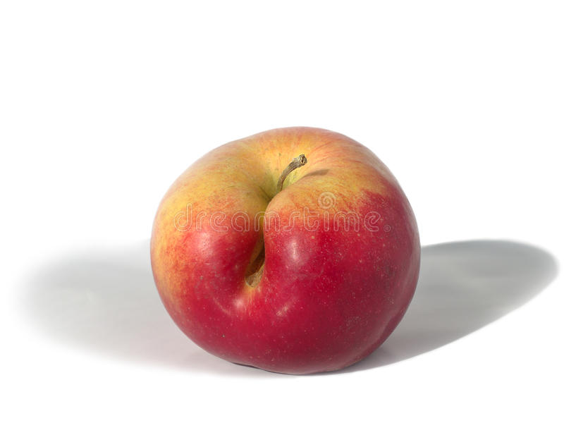 Yellow-red apple with a flaw. On a white background stock images