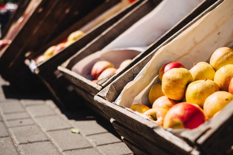 Yellow and Red Apples on Brown Crate stock photography