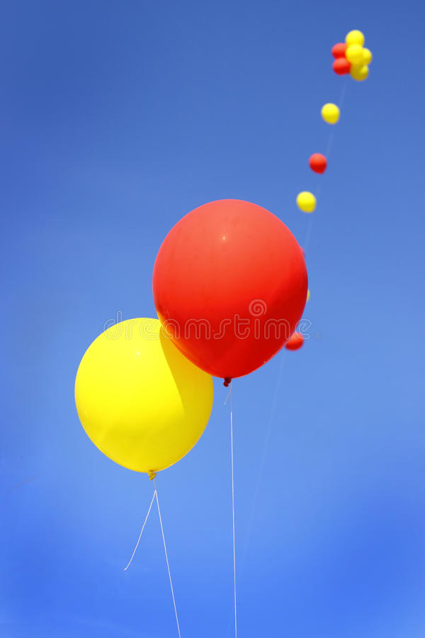 Yellow and red balloons stock photos