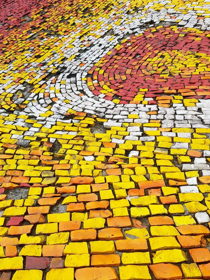 Yellow and Red Brick Walking Path. The stone texture in yellow color royalty free stock photos