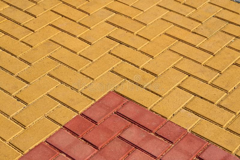 Yellow and red brown paving tile for background or texture stock images