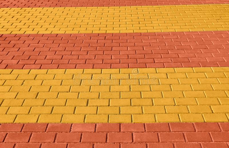 Yellow and red brown paving tile for background or texture royalty free stock photos