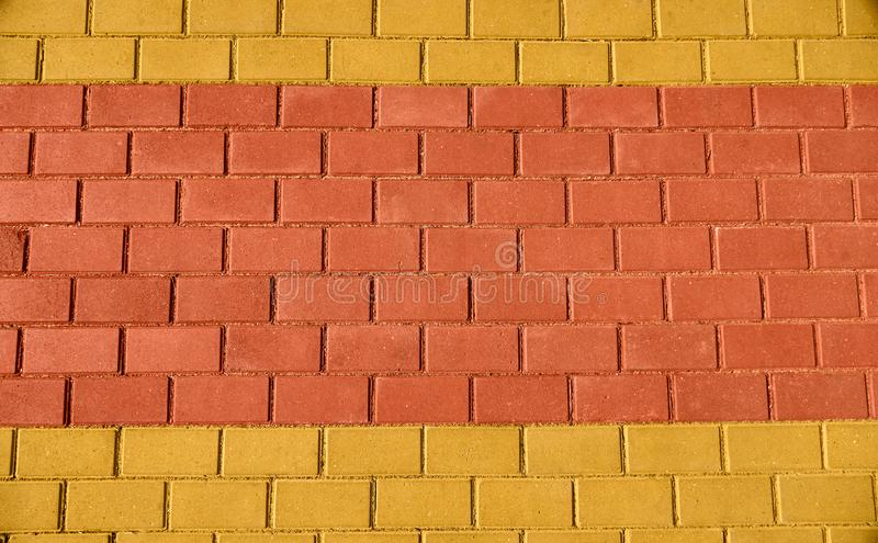 Yellow and red brown paving tile for background or texture stock photo