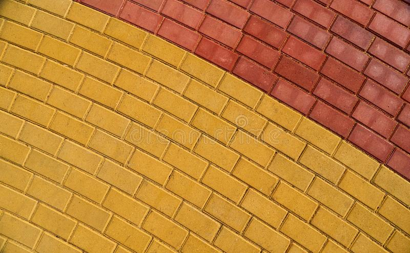 Yellow and red brown paving tile for background or texture royalty free stock photo