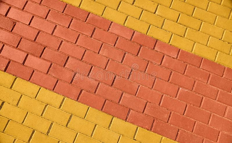Yellow and red brown paving tile for background or texture stock photos