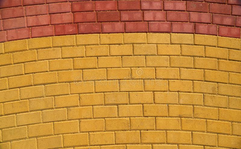 Yellow and red brown paving tile for background or texture royalty free stock photography